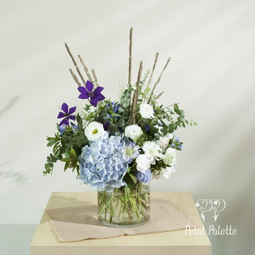 Cool tone flower vase arrangement with branches seoul florist