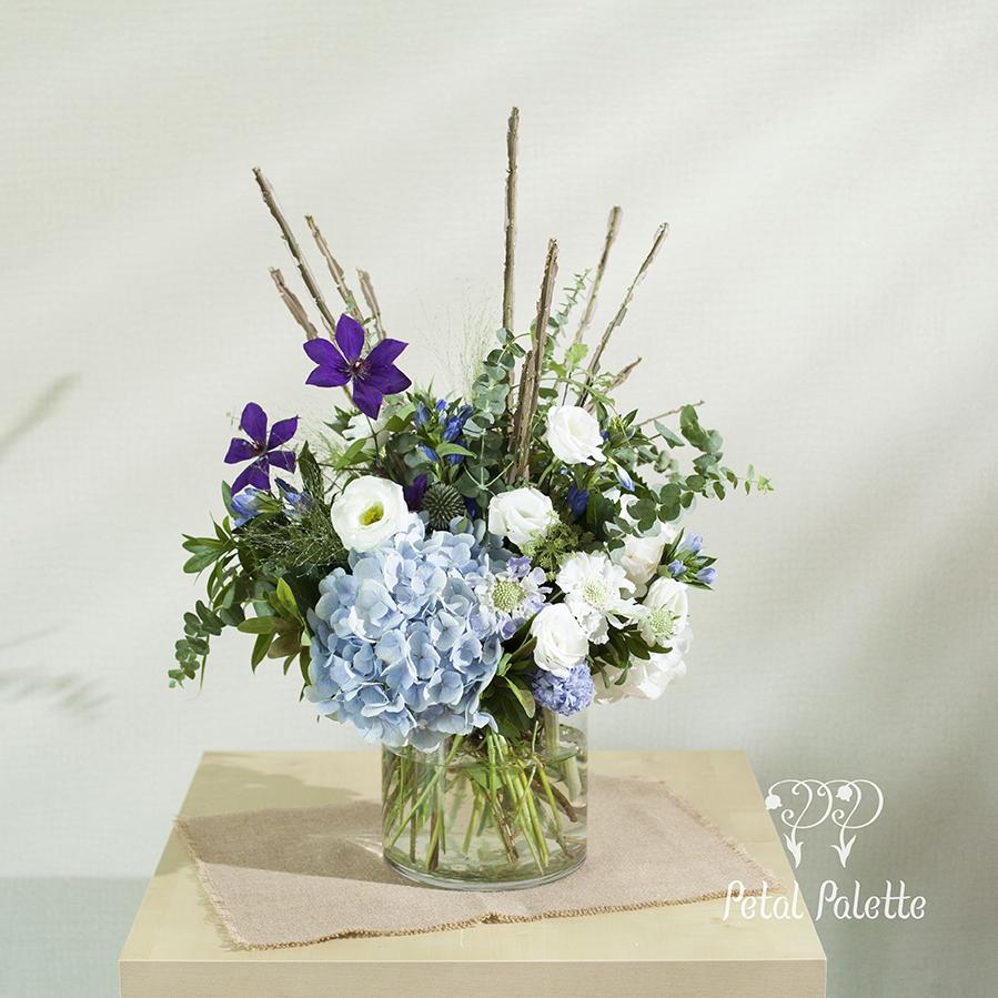 Cool tone flower vase arrangement with branches seoul florist